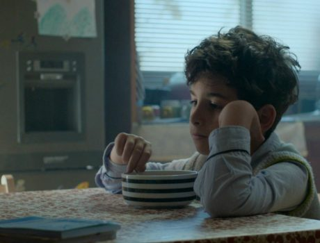 child eating breakfast with noone around