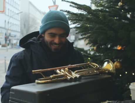 man with a trumpet at a piano