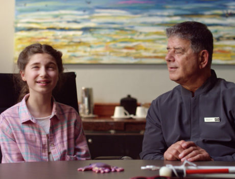 a man closes his eyes and tries to experience what a blind girl experiences